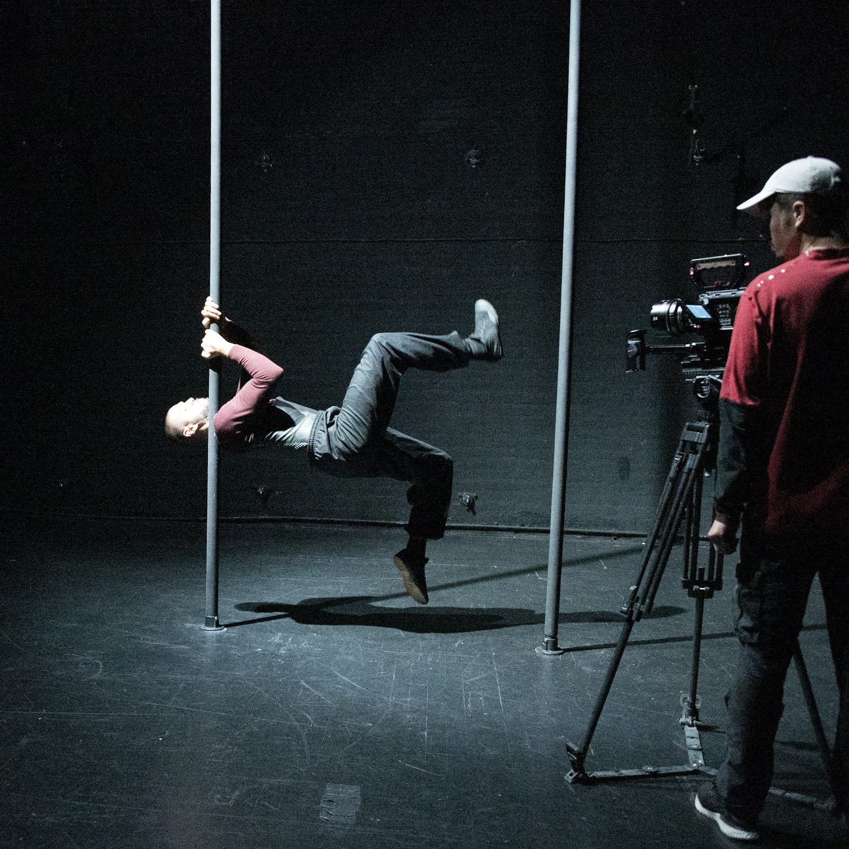 A man is filmed about to balance on a chinese pole