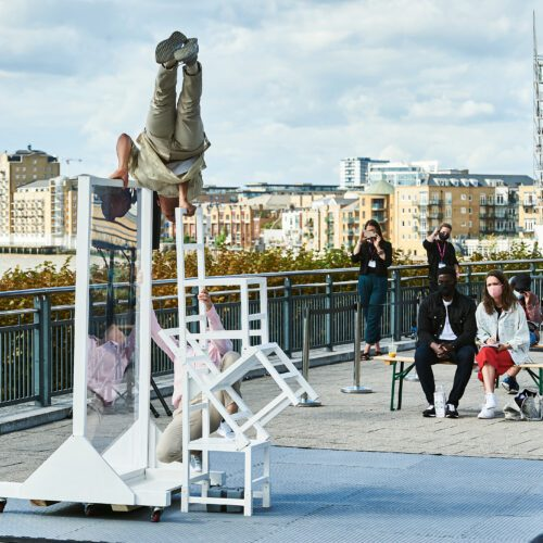 A socially distanced audience watches two dancers in an outdoor performance